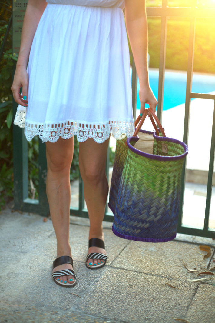 outfit: white off shoulder dress with embroidered hem and straw tote bag