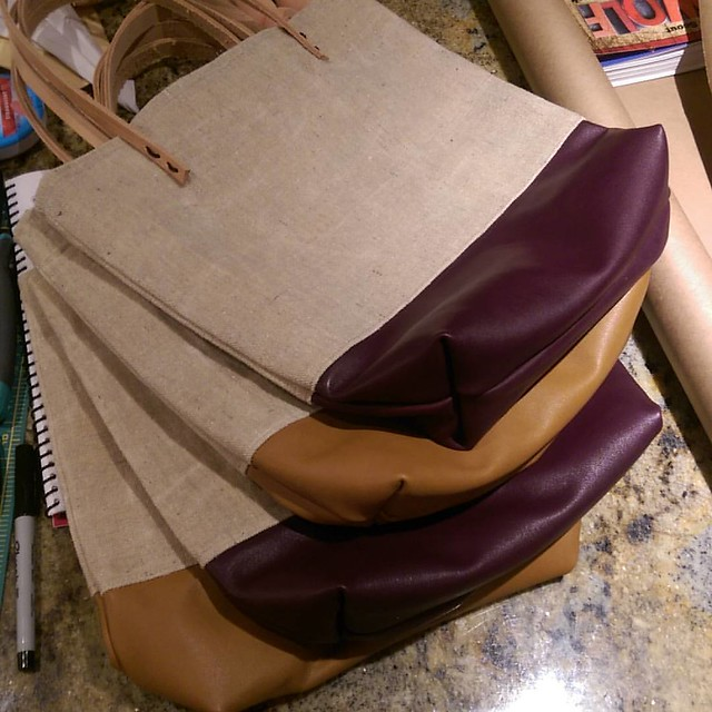 """I finished 4 bags today and made one compete bag today.  That's 5 canvas and leather tote bags brought to you by my arthritis, my love of sewing, etsy, abd one very lazy 3 year old who doesn't want to do anything but, """"watch a show""""."""