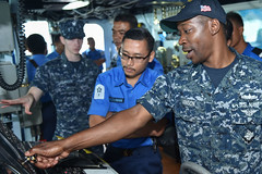 Sailors aboard USS Lassen (DDG 82) point out equipment on the bridge to visiting Royal Malaysian Navy counterparts during a tour of the ship in Kota Kinabalu. (U.S. Navy/MC2 Corey T. Jones)