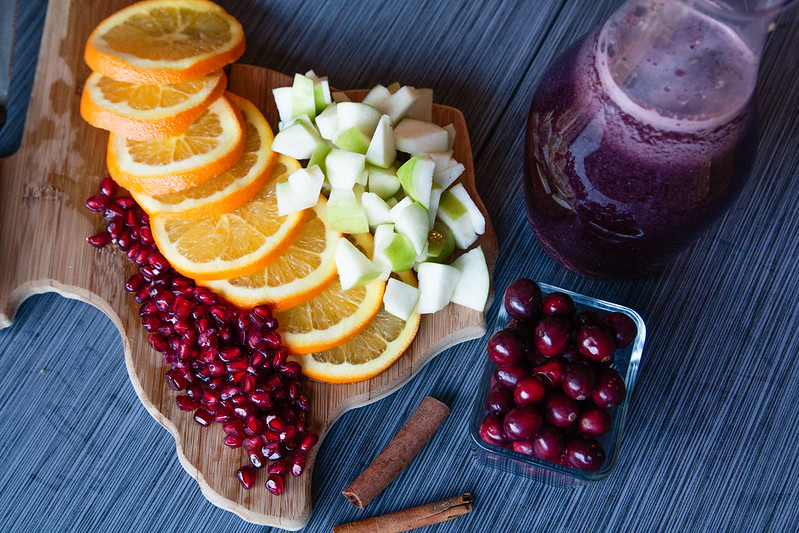 cute & little blog   holiday pomegranate orange apple sangria - Holiday Sangria Recipe by popular Dallas blogger cute & little