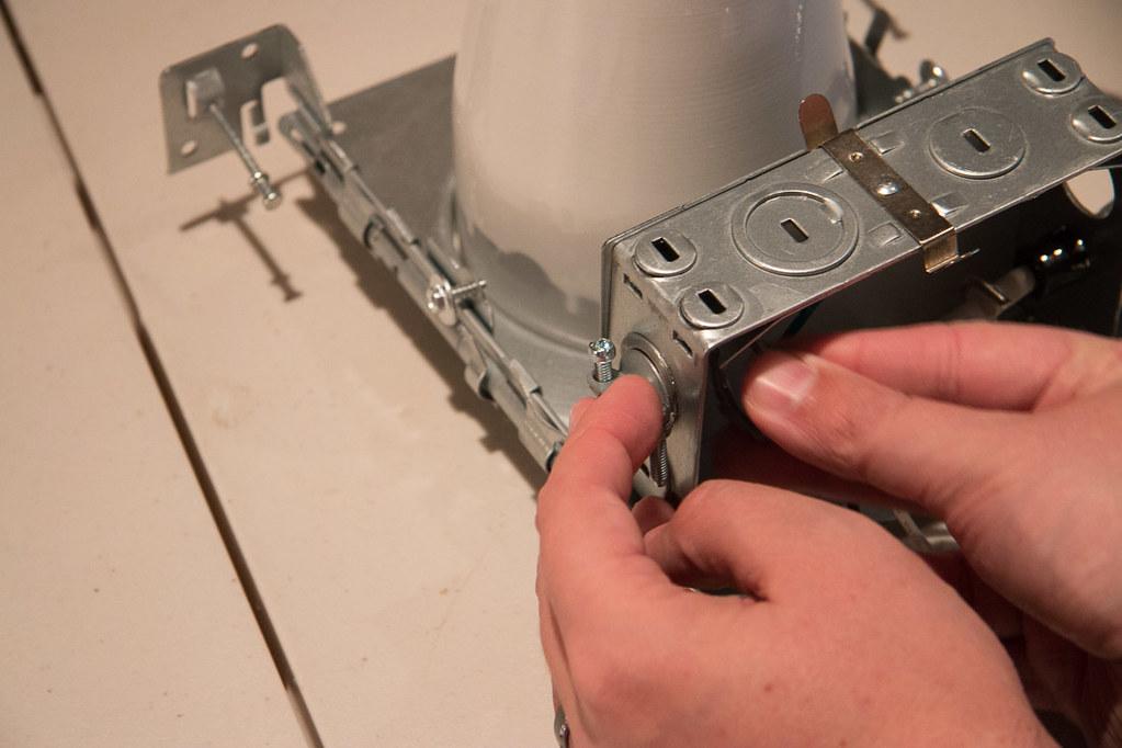 Installing clamp connectors on recessed lighting fixture