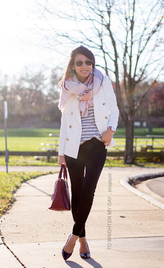 pink plaid scarf, gray striped turtleneck, white blazer, black pants, oversized watch, burgundy pumps