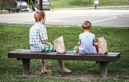 Two young boys enjoying lunch near their home in Knox County, Ky
