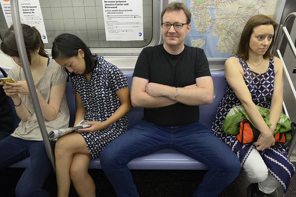 Women Crowded by Manspreading on Subway