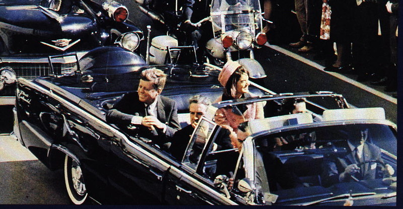 John F. Kennedy with his wife in the presidential limousine, some seconds before the assassination