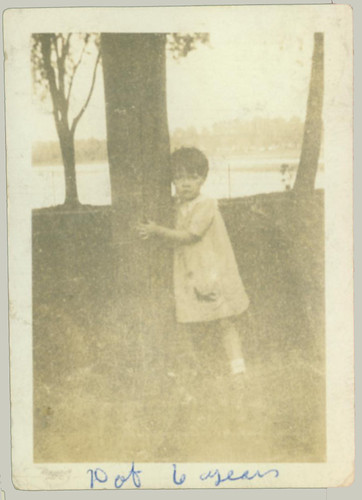 Girl hugging a tree
