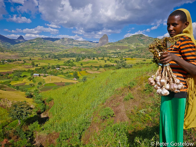 Garlic seller and beautiful view