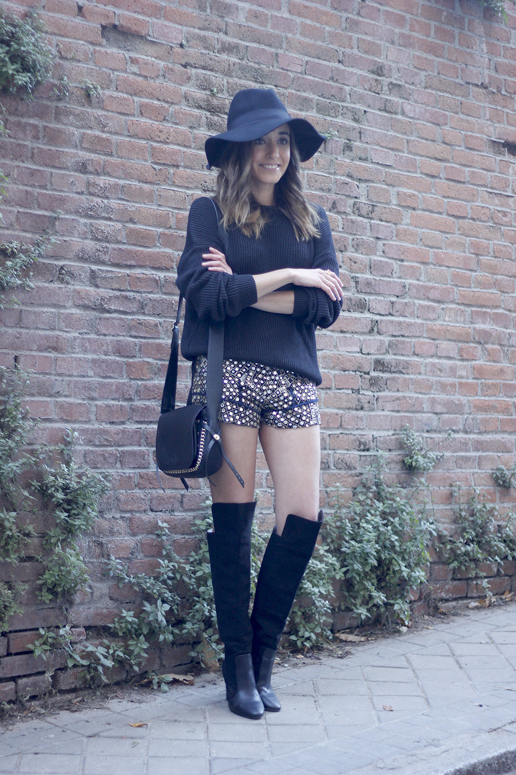 embroidered shorts black hat over the knee boots black sweater pull and bear purse coach outfit20