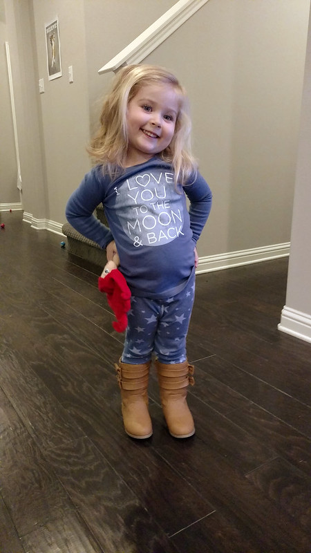 Trying on her new boots