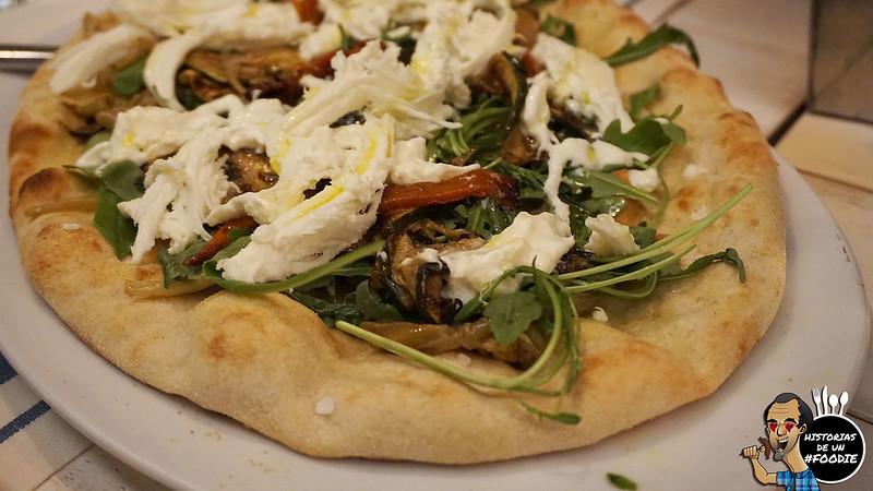 Pizza prosciutto crudo di Parma (Salsa de Tomate, Mozzarella de Búfala, Jamón de Parma y Rúgula)