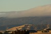 This morning the Marine Layer is being pushed over the foothills. Looks like fall is starting early this year.