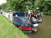Motorbike on the back of a canal boat