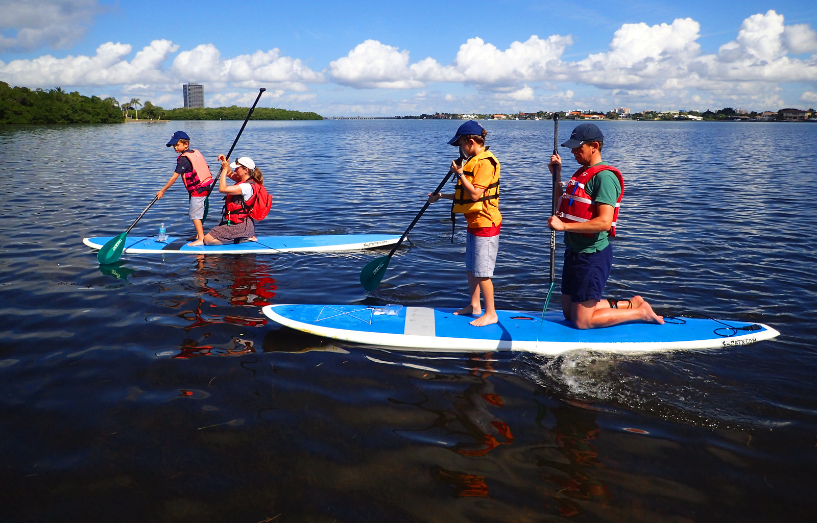 Patient parents allowing their kids to take the paddling job for awhile.