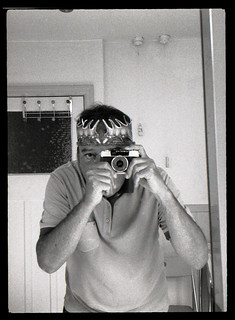 reflected self-portrait with Olympus Pen EE-3 camera and rustic crown