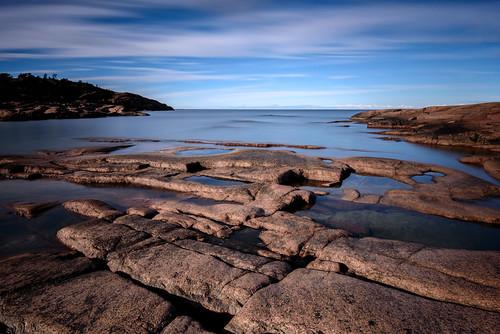 longexposure blue trees sea sky beach water rock landscape coast nikon rocks outdoor shore d750 serene åland havsvidden