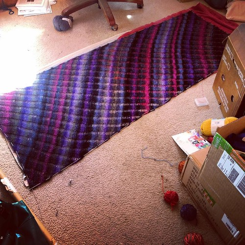 In the midst of CFR7 packing, I am blocking my wonderful #clapotis shawl.