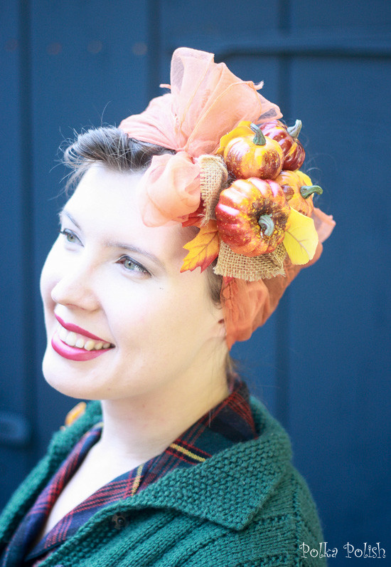 Fall hairdo with a vintage orange chiffon scarf and mini pumpkins