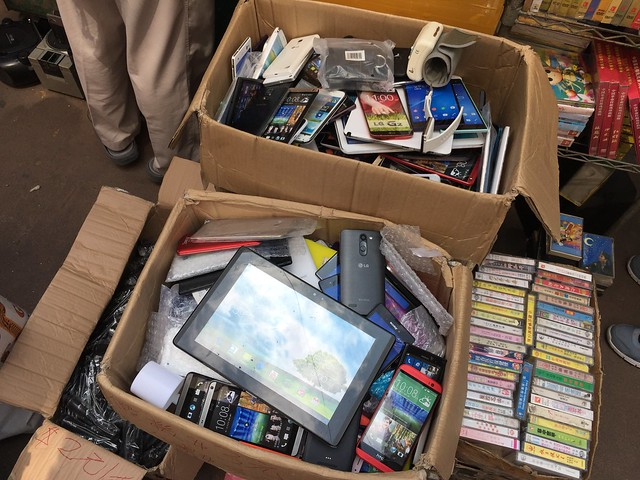 Boxes of dummy phones and tablets at Aplui Flea Market, Hong Kong