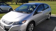 automobile(1.0), automotive exterior(1.0), wheel(1.0), vehicle(1.0), honda(1.0), bumper(1.0), honda civic hybrid(1.0), honda insight(1.0), sedan(1.0), land vehicle(1.0), honda civic(1.0),