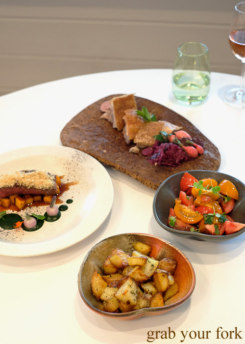 Oyster blade steak, suckling pig, tomato salad and roasted potatoes by Pilu at Freshwater, Sydney