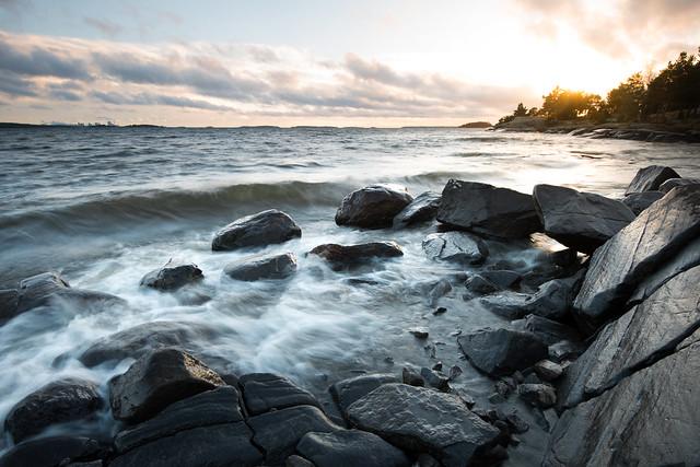 Wet rocks and setting sun