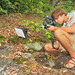 Daniel Thompson, photographing Crotalus horridus, Communal Rookery, Chattahoochee National Forest, Lumpkin County, Georgia 1 by Alan Cressler