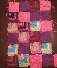 Getting there. Still need a bit of color variation. #afghan #knit #stashbusting #sockyarn #miteredsquares #patchwork