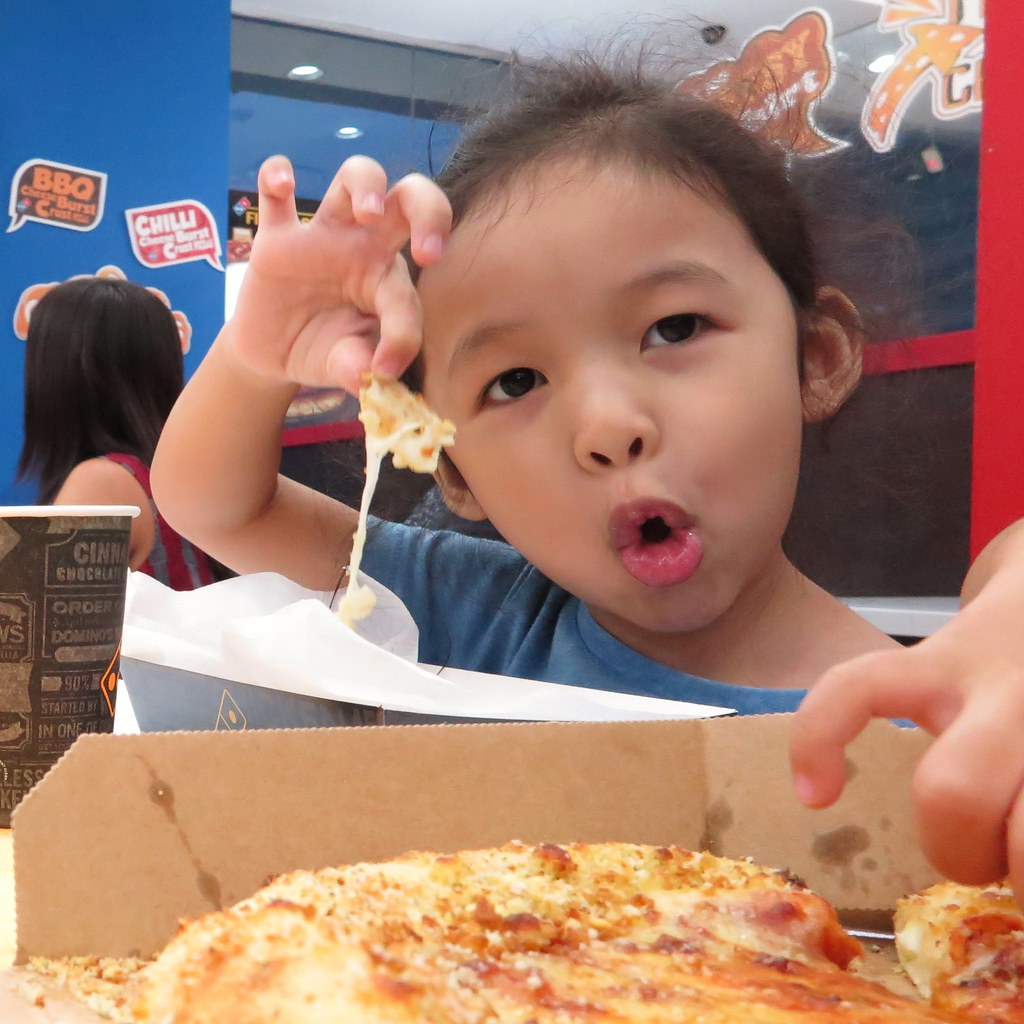 Ayra totally enjoying her regular size Cheesy Crust Simply Cheese Domino's Pizza