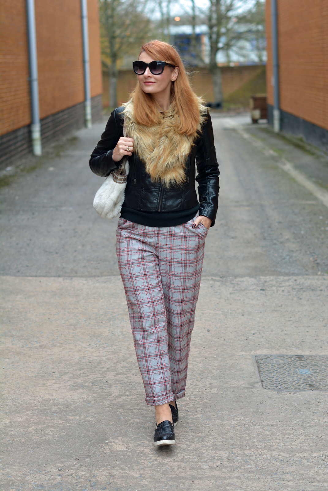 Faux fur collar, biker jacket, plaid pants, black slip-on shoes