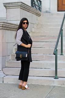 long black vest, striped shirt, white mules, black pants.jpg
