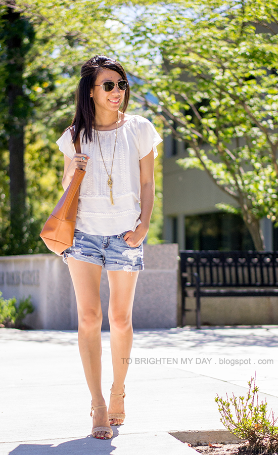 lace and crochet top, tassel necklace, ring with stones, distressed shorts, raffia sandals