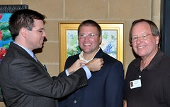 President Chris Morden pins the club's newest member, Brent Wright. Past President Boyd Bennett has know Brent and his family for many years and recommended him for membership.