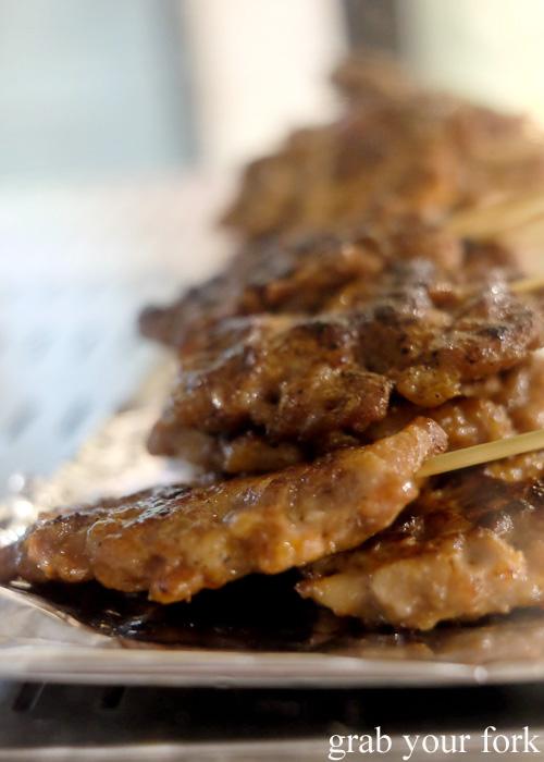 Moo pung ping grilled minced pork skewers at Kin Senn Thai street food restaurant, Sydney