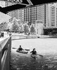 Kayaks and Bridges in BW by streetlevel_photography