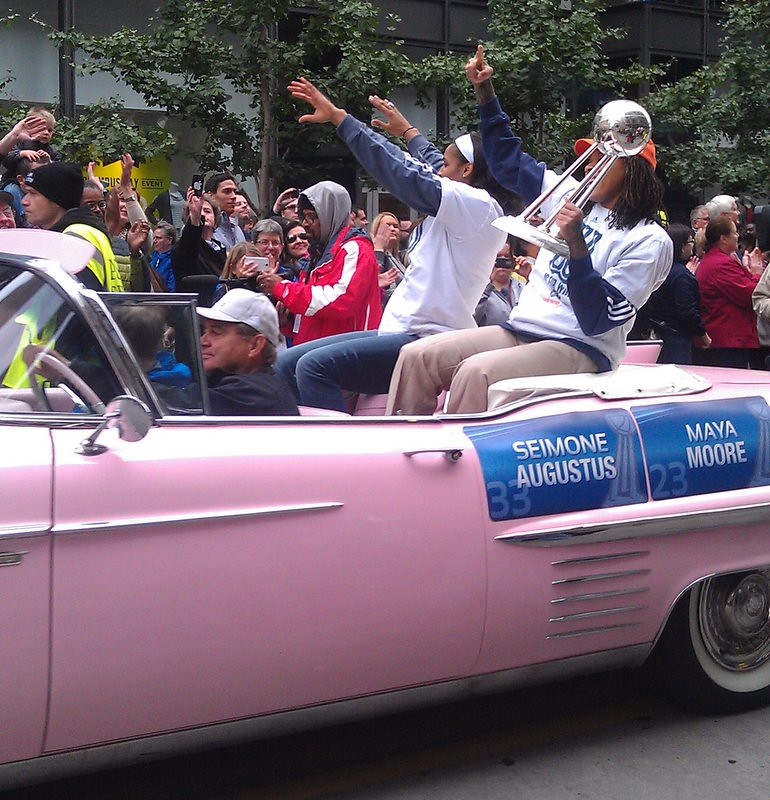 Maya Moore and Seimone Augustus in the 2013 championship parade