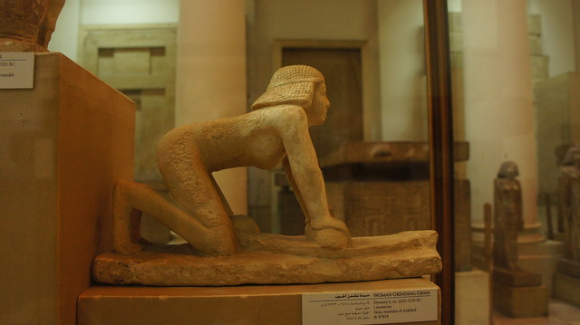 A statue of an ancient Egyptian woman gaining some grains at the Egyptian Museum of Cairo