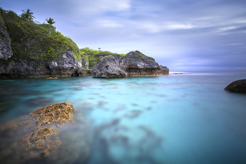 limu pools sunset niue pacific ocean shoreline coral reef atoll island rock turquoise aqua