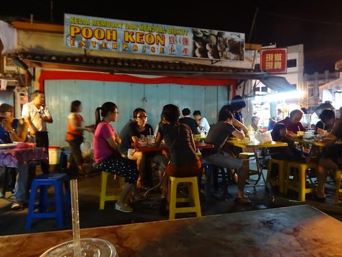 Eating satay in Melaka, Malaysia