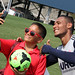 Juan Agudelo and a fan take a selfie at Revs Training
