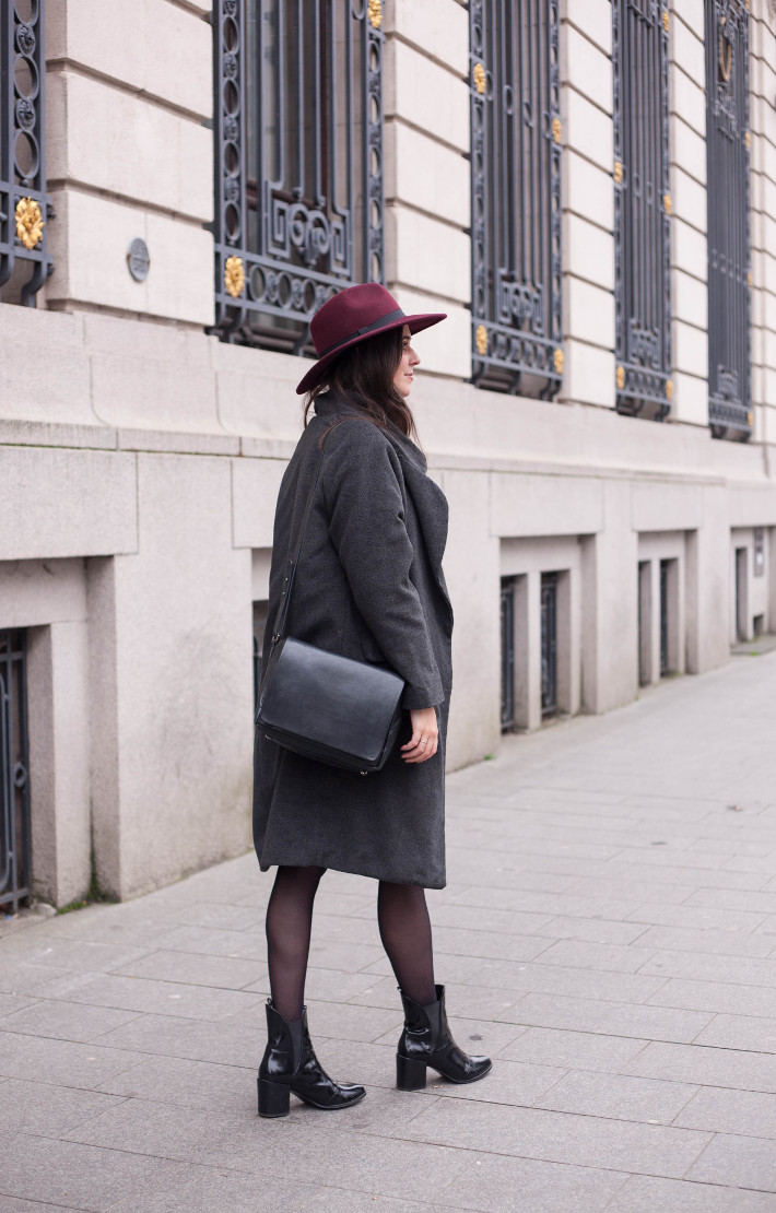 outfit: burgundy hat, longline winter coat and patent chelsea boots