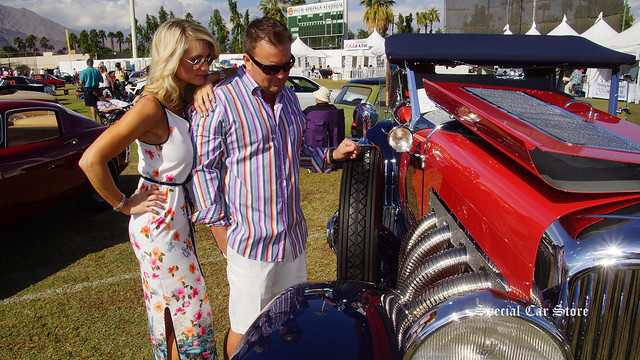 Models wearing Tommy Bahama in front of 1929 Duesenberg Model J Dual Cowl Phaeton
