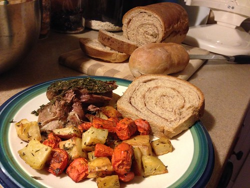 Crock-pot pot roast. Oven-roasted veggies. Home made cinnamon swirl whole wheat bread. Yum.