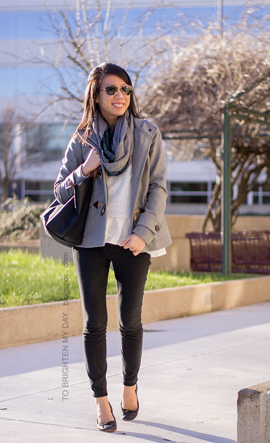 gray toggled coat, plaid and herringbone infinity scarf, gray ruffled sweater, black pants, black ballet flats
