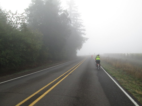 Corey and Stefanie on the tandem, and Susan O up ahead in the fog