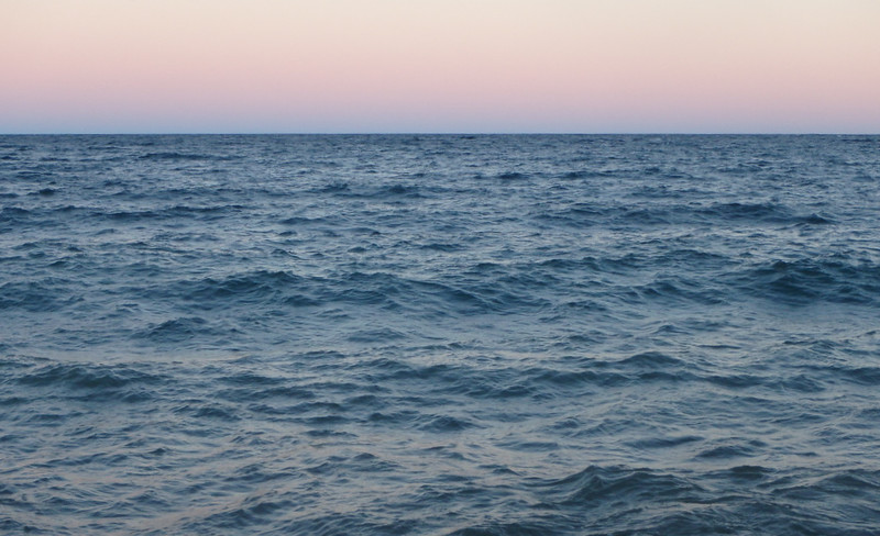 wavy Lake Superior with a pink sky