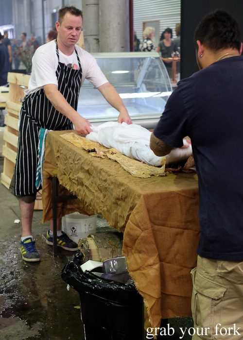 Wrapping the pipis and mussels in a sheet, paper bark and calico to be cooked in the Aboriginal earth oven at Rootstock Sydney 2015