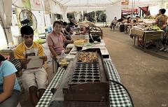 Man selling Bibinka at a Food Festival