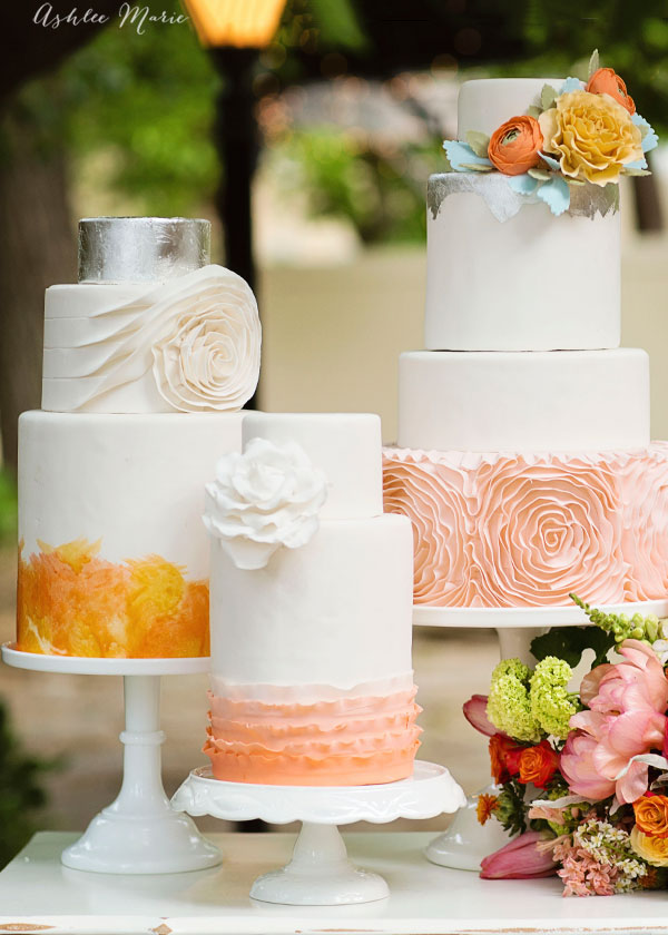 it doesn't get much more stunning at a wedding that a trio of cakes that bring out the wedding colors, flowers and stunning details