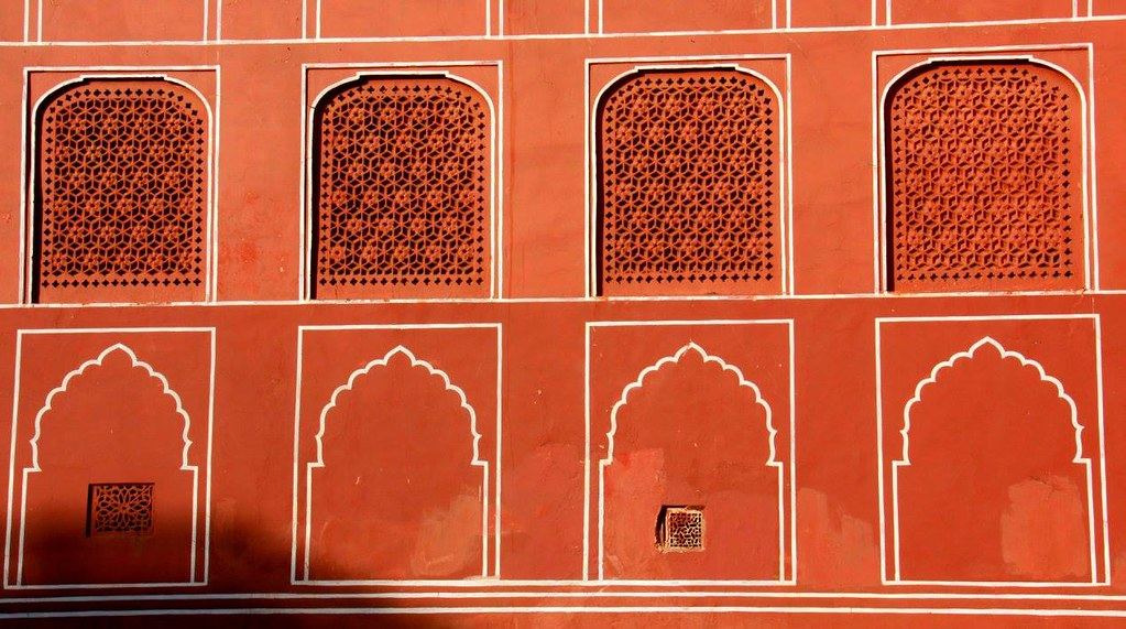 terracotta colour walls of the city palace jaipur