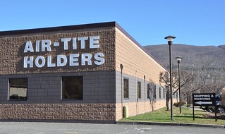 Air-Tite coin holders building